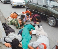 People lying on the ground during an attack.